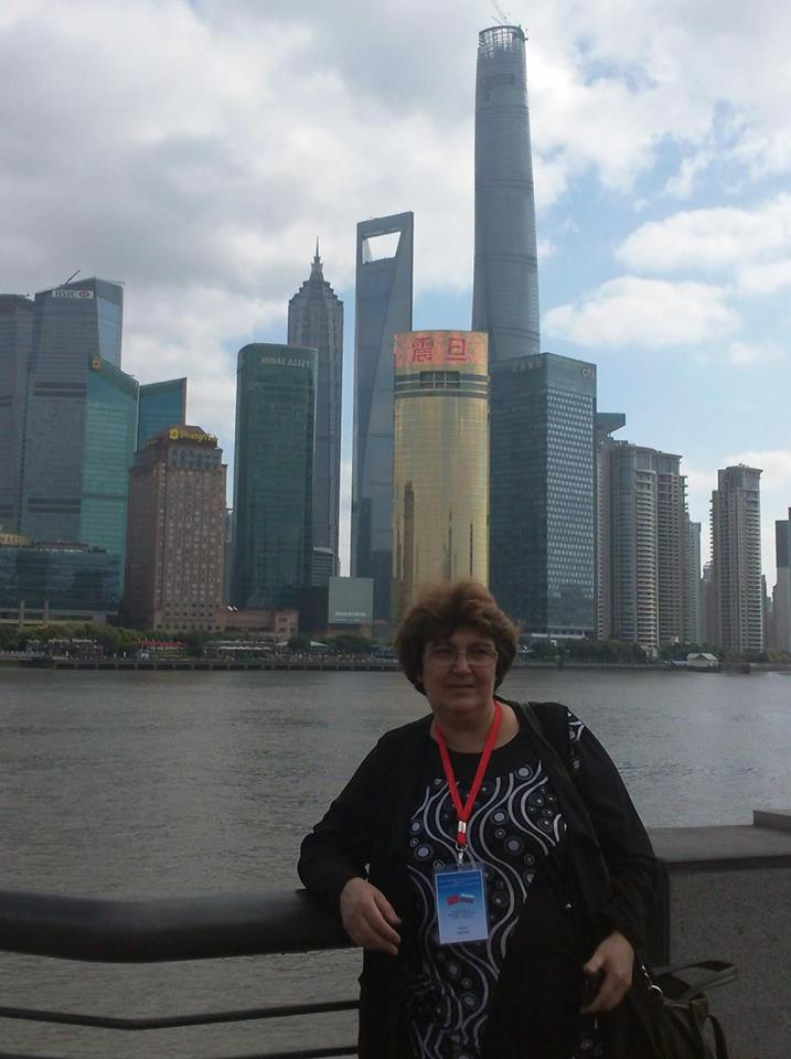 В Шанхай.